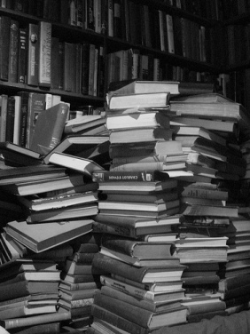 Stacks of dusty books black and white