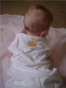 Baby in Noah's Inspirations onesie. Back logo. All rights reserved.
